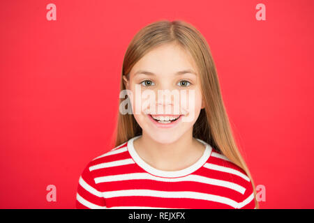 Childhood happiness. family and love. childrens day. Good parenting. Child care. small girl child. School education. happy little girl on red background. Cheeky little girl. - Stock Photo