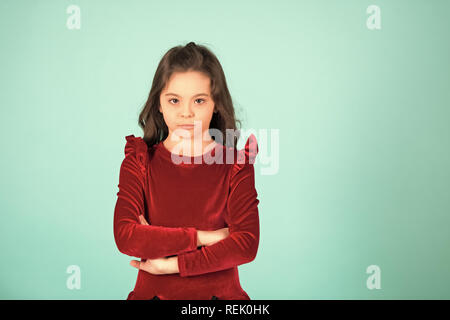 Little girl in red dress pose on blue background, fashion. Fashion, beauty, look concept. Child, childhood, youth. Punchy pastel trend, copy space - Stock Photo