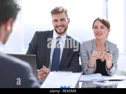 group of business people discussing a new financial project - Stock Photo