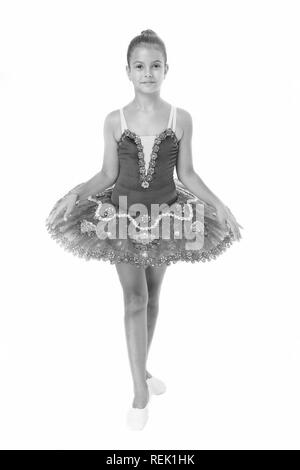 little girl in ballet position. Little ballerina in blue tutu. Adorable ballerina girl take dance lesson. Dancing queen. It takes discipline to be the best. - Stock Photo