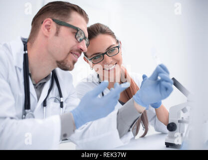two scientists are conducting tests in the laboratory - Stock Photo