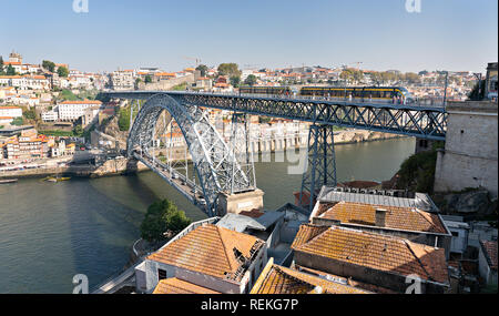 Subway Train crossing the Dom Luis I Bridge in Porto Portugal. Panoramic view photography - Stock Photo