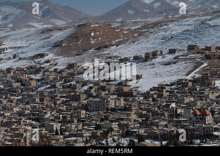 Arsal, a small isolated border town in north-eastern Lebanon, on the border with Syria, that not long ago was a stronghold of the Islamic State of Iraq and the Levant (ISIL, also known as ISIS). The town is now home t at least 65,000 Syrian refugees. - Stock Photo