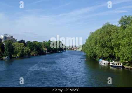 View along the River Thames from Kingston Railway Bridge looking towards Richmond Upon Thames and the landmark Star and Garter Home.  Sunny afternoon  - Stock Photo