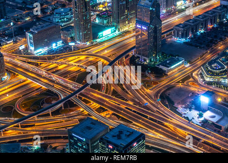 Aerial view of a highway road interchange in Dubai at night, United Arab Emirates - Stock Photo