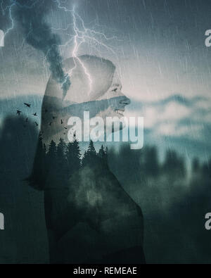 Happy young woman traveler spirit silhouette double exposure effect over foggy mountains fir forest. Relaxing duotone cold landscape with storm in the - Stock Photo