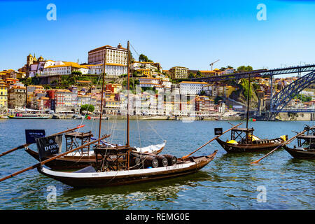 Traditional Rabelo boat on the River Douro in Porto, Portugal, used for transporting Port wine - Stock Photo