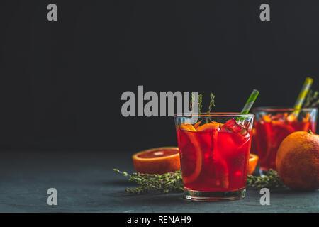 Campari traditional Italian alcoholic liqueur on black concrete background, copy spice, shallow depth of the field. - Stock Photo