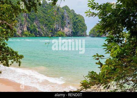 Ao Nang, Krabi - Pai Plong Beach through the foliage of the Monkey Trail. - Stock Photo