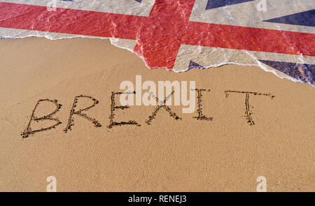 Handwrite text Brexit on sand coastline and foam wave with Great Britain flag pattern. On referendum, voted to exit United Kingdom from EU knows as Br - Stock Photo