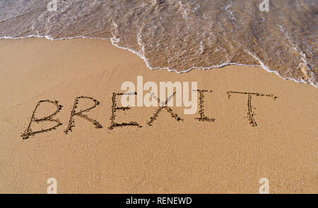 Handwrite text Brexit on sand coastline and foam wave. On referendum, voted to exit United Kingdom from European Union - knows as Brexit, which is exp - Stock Photo