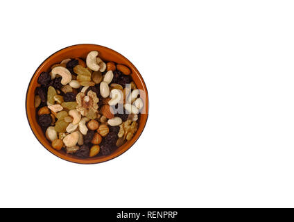 Mixture of nuts and dried fruits on an isolated white background. top view. - Stock Photo