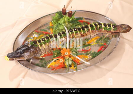 Table served with stuffed pike, vodka, moonshine in a restaurant - Stock Photo