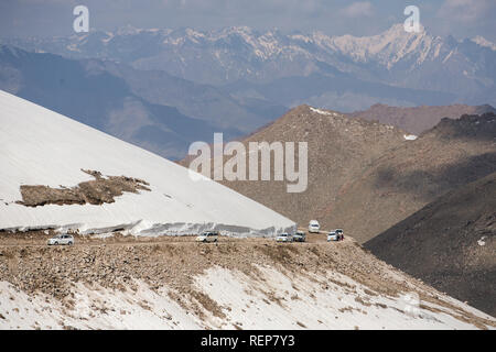 Traffic on high altitude road at Khardung La pass, Ladakh, India. The elevation of Khardung La pass is 5,359 m. - Stock Photo