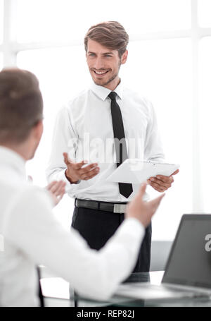 two businessmen discussing something in the office - Stock Photo