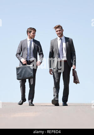 business people walking on the city street - Stock Photo