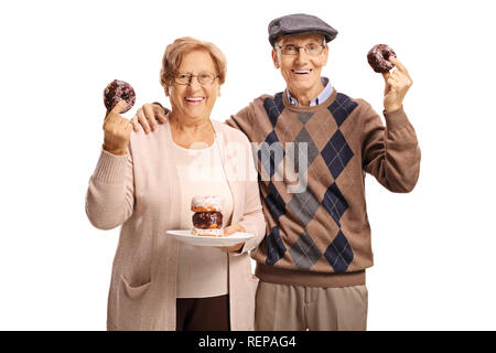 Senior couple holding donuts isolated on white background - Stock Photo
