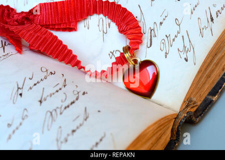 Heart on old book - Stock Photo