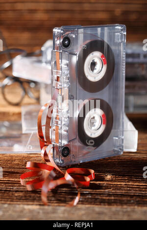 Classic audio cassette with pulled out of tape with empty space for text - Stock Photo