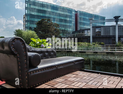 chaise lounge in leather on house boat with the steel and glass kings cross development behind - Stock Photo