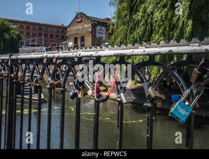 love locks at camden lock. padlocks on fence. - Stock Photo