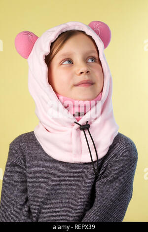 Beautiful girl in a hat in the shape of a sheep - Stock Photo