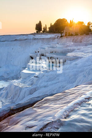 Pools of Pamukkale in Turkey in sunset, contains hot springs and travertines, terraces of carbonate minerals left by the flowing water, UNESCO World H - Stock Photo