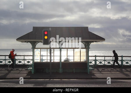 Scene promenade shelter and traffic light and pedestrian in Marine Parade, Brighton & Hove, England, UK - Stock Photo