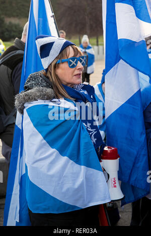 SNP supporters holding a rally outside the Scottish Parliament in Edinburgh calling for a second independence referendum. - Stock Photo
