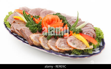 Sliced meat with vegetables on a white background - Stock Photo
