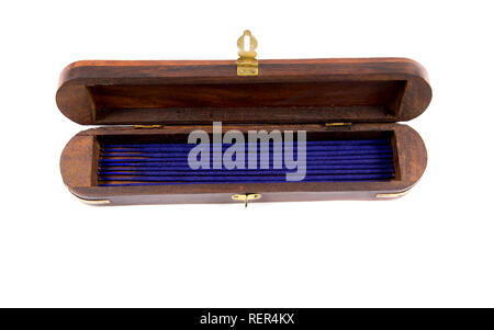 Wooden opened incense holder box with storage case, incense sticks candles inside, isolated on white. - Stock Photo