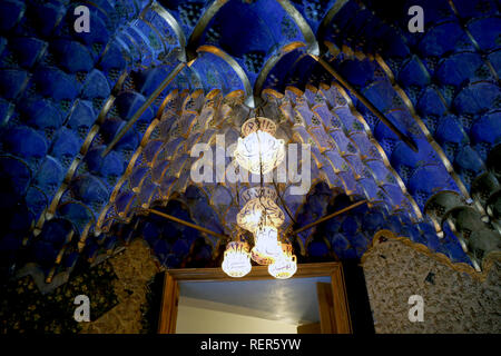 Casa Vicens, built from 1883 to 1885. First project of the architect Gaudí. Vault with arabesques in blue color. Ceiling glass light with characters. - Stock Photo