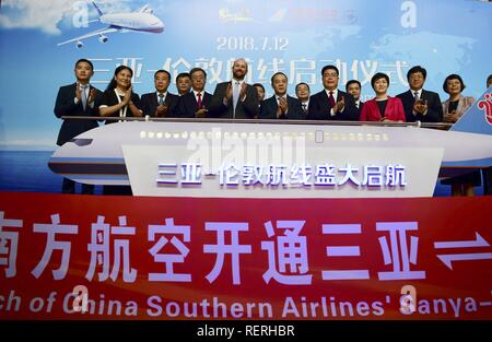 (190123) -- BEIJING, Jan. 23, 2019 (Xinhua) -- The starting ceremony of Sanya-London direct flight is held at Fenghuang International Airport in Sanya, south China's Hainan Province, July 12, 2018. China's civil aviation industry is accelerating its advance into the digital era, with major players sending clear signals of new opportunities worldwide. - Stock Photo