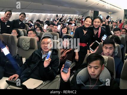 (190123) -- BEIJING, Jan. 23, 2019 (Xinhua) -- Passengers show their mobile phones accessing aviation internet on Flight MU553 of China Eastern Airlines Jan. 18, 2018. China's civil aviation industry is accelerating its advance into the digital era, with major players sending clear signals of new opportunities worldwide. (Xinhua) - Stock Photo