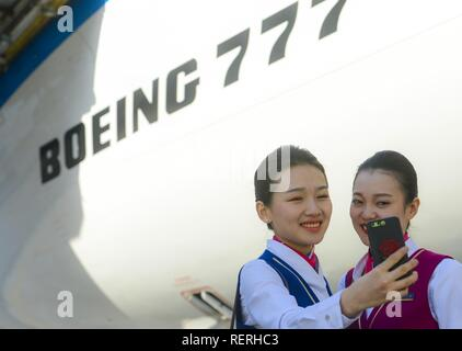 (190123) -- BEIJING, Jan. 23, 2019 (Xinhua) -- Huang Anqi, crew chief of  Xinjiang branch of China Southern Airlines, poses for a group photo with her colleague before flight B2051 in Urumqi, capital of northwest China's Xinjiang Uygur Autonomous Region, May 20, 2018. China's civil aviation industry is accelerating its advance into the digital era, with major players sending clear signals of new opportunities worldwide. (Xinhua/Zhao Ge) - Stock Photo