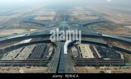 (190123) -- BEIJING, Jan. 23, 2019 (Xinhua) -- Aerial photo taken on April 28, 2018 shows a new Beijing airport under construction in Daxing District of Beijing, capital of China. China's civil aviation industry is accelerating its advance into the digital era, with major players sending clear signals of new opportunities worldwide. - Stock Photo