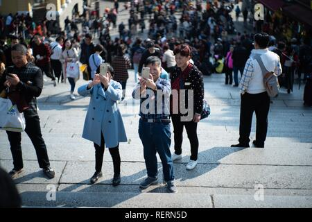 Macao, China. 23rd Jan, 2019. Tourists visit the Ruins of St. Paul's in Macao, south China, Jan. 23, 2019. Visitor arrivals in China's Macao Special Administrative Region (SAR) made a record of 35.80 million in 2018, up by 9.8 percent year-on-year, the SAR's statistics service said on Wednesday. Visitor arrivals by land surged by 18.9 percent year-on-year to 22.15 million in 2018, with 1.05 million of them entering the Macao SAR via the Hong Kong-Zhuhai-Macao Bridge. Credit: Cheong Kam Ka/Xinhua/Alamy Live News - Stock Photo