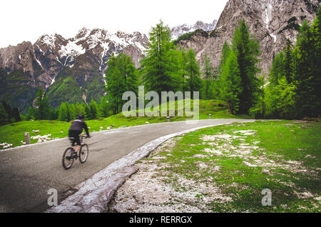 blurred cyclist mountain landscape background - Stock Photo