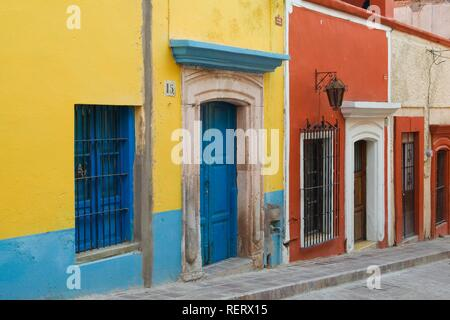 Colourfully painted houses, historic town of Guanajuato, UNESCO World Heritage Site, Province of Guanajuato, Mexico - Stock Photo