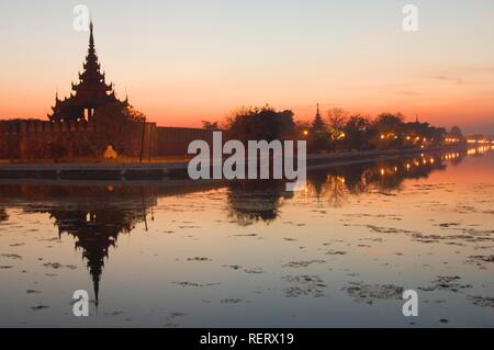 Sunset over the canal surrounding the Royal Palace, Mandalay, Burma, Myanmar, Southeast Asia - Stock Photo