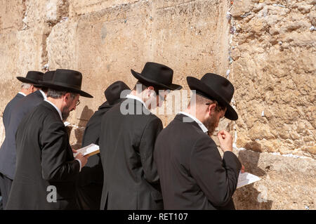 Orthodox Jews praying at the Western Wall, Jerusalem, Israel - Stock Photo