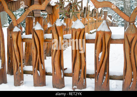 Brest, Belarus - January 11, 2019: Fence of carved wooden pillars in the ancient style - Stock Photo