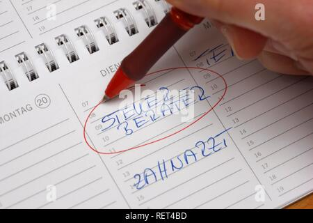 Entry in a private calendar, tax accountant and dentist's appointment - Stock Photo