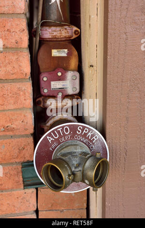 Fire hose standpipe dry risers main on outside building for firefighting sprinkler system - Stock Photo
