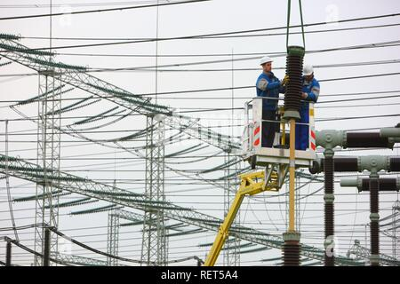 Workers doing maintenance work in a transformer station of the ELE, Emscher Lippe Energie GmbH, a subsiduary of the RWE, Marl - Stock Photo