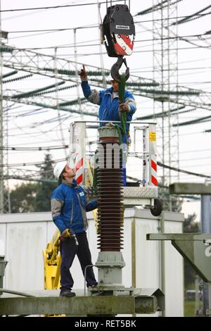 Workers doing maintenance work in a transformer station of the ELE, Emscher Lippe Energie GmbH, a subsiduary of RWE, Marl - Stock Photo
