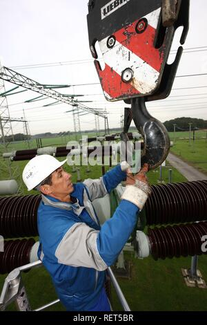 Worker doing maintenance work in a transformer station of the ELE, Emscher Lippe Energie GmbH, a subsiduary of RWE, Marl - Stock Photo