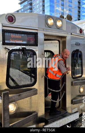 Driver on light rail train at Union Station in downtown Denver which goes to Denver International Airport, Colorado, USA - Stock Photo