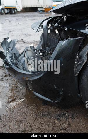 Car crash / vehicle damage; Head on crash, front bumper damage. - Stock Photo