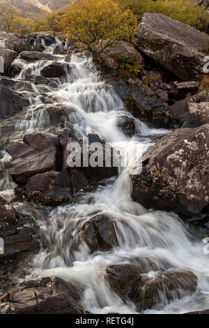 The stream that flows from Llyn Idwal forms a waterfall near Ogwen Cottage, Snowdonia National Park - Stock Photo